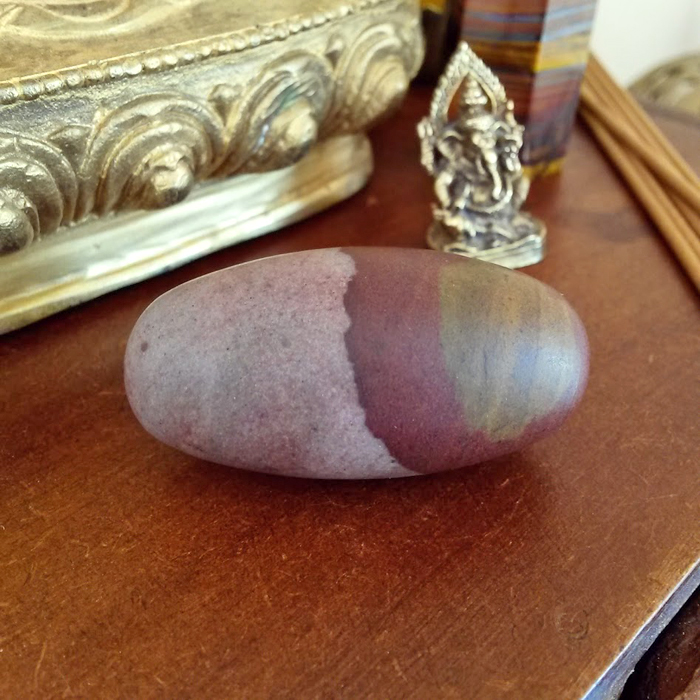 Shiva Lingam Meaning: Grounding, balances male and female energy.