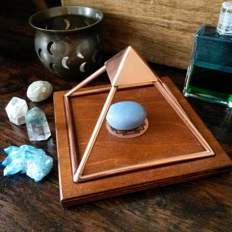 Cleanse crystal grids under a copper pyramid
