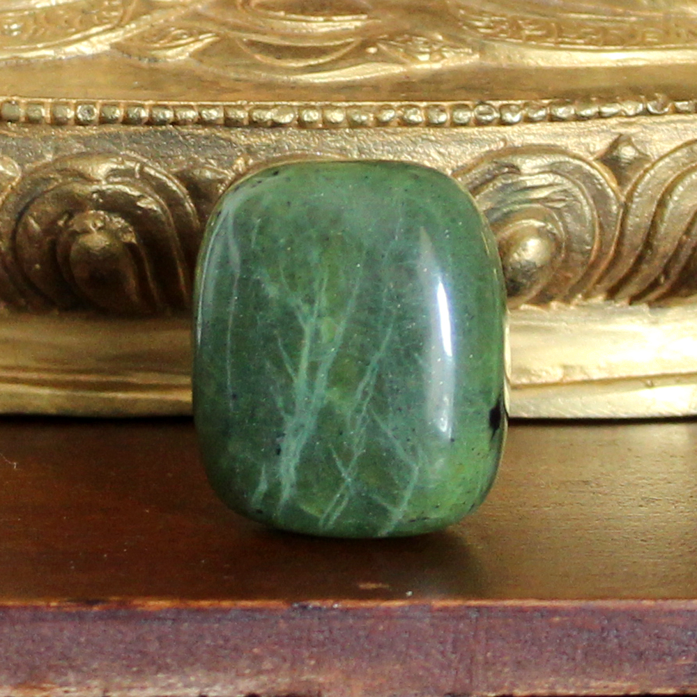 Nephrite Jade Tumble Stone. Jade comes in many shades of green.