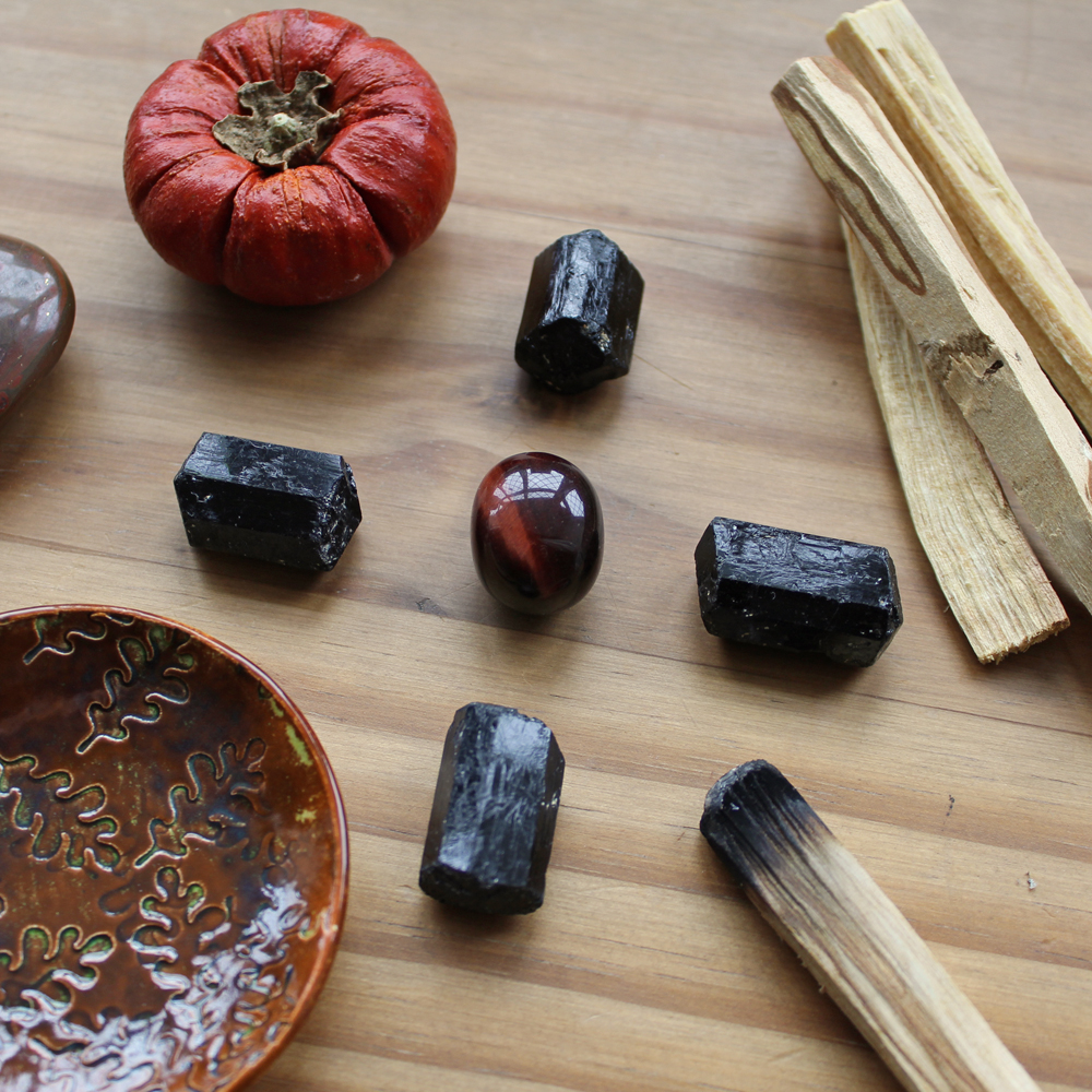 Burning Palo Santo helps cleanse and bless your crystals