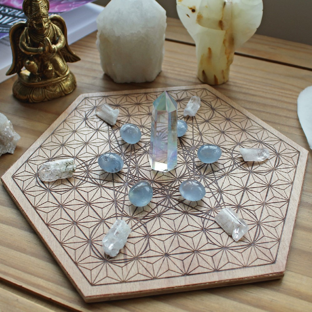 This crystal grid uses a wooden base with sacred geometry
