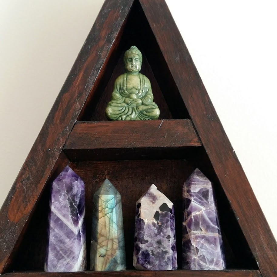 Triangular wall altar with crystals and buddha