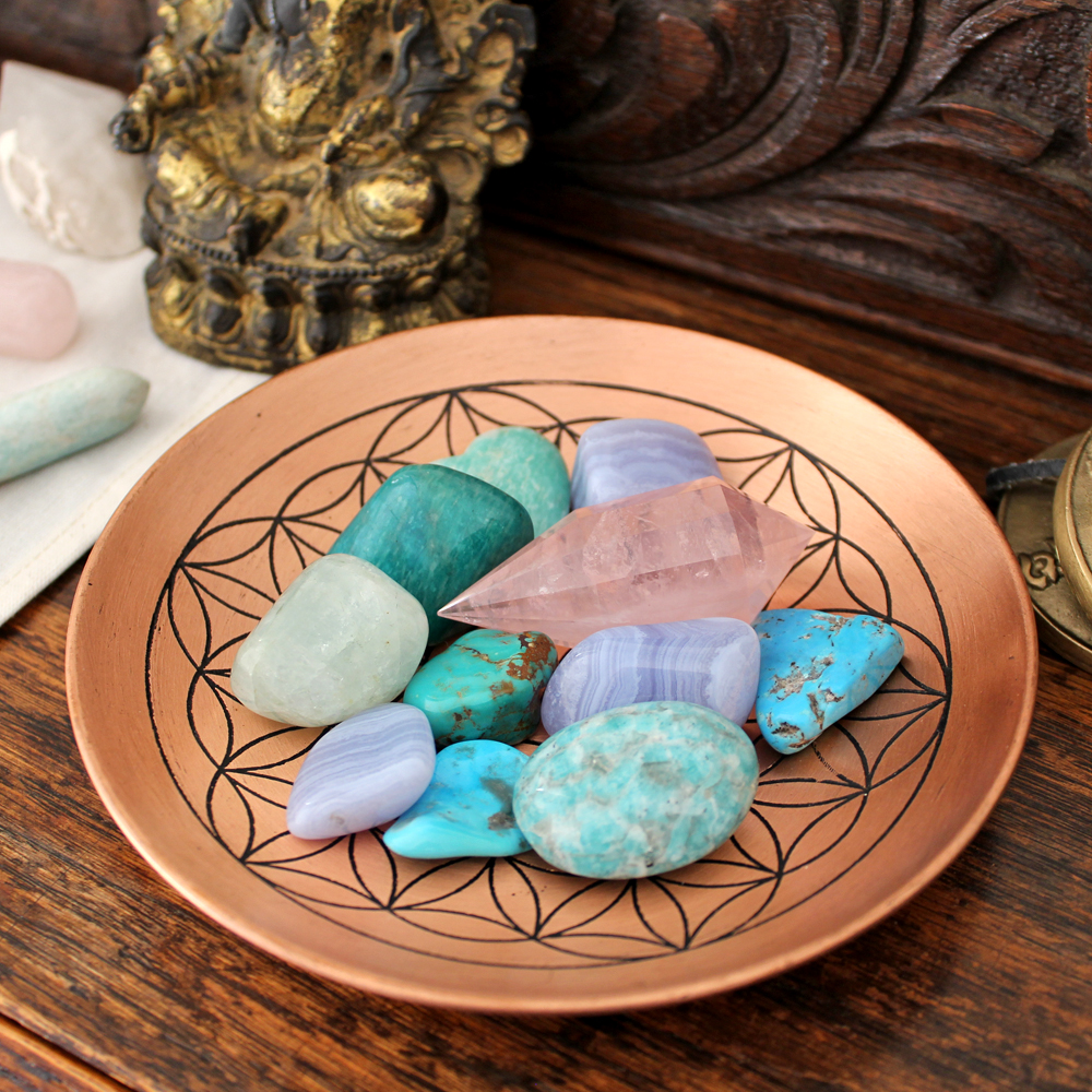 Flower of life bowl filled with different crystals