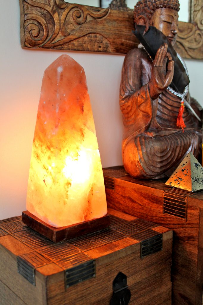 Obelisk salt lamp with buddha statue