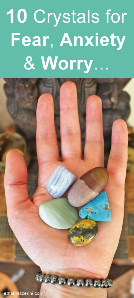 Crystals for fear, anxiety and worry. Hand holding crystals