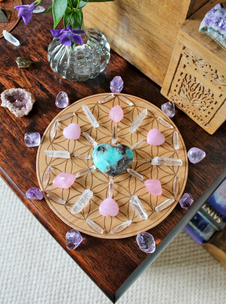 Crystal grid with heart shaped crystals on an altar
