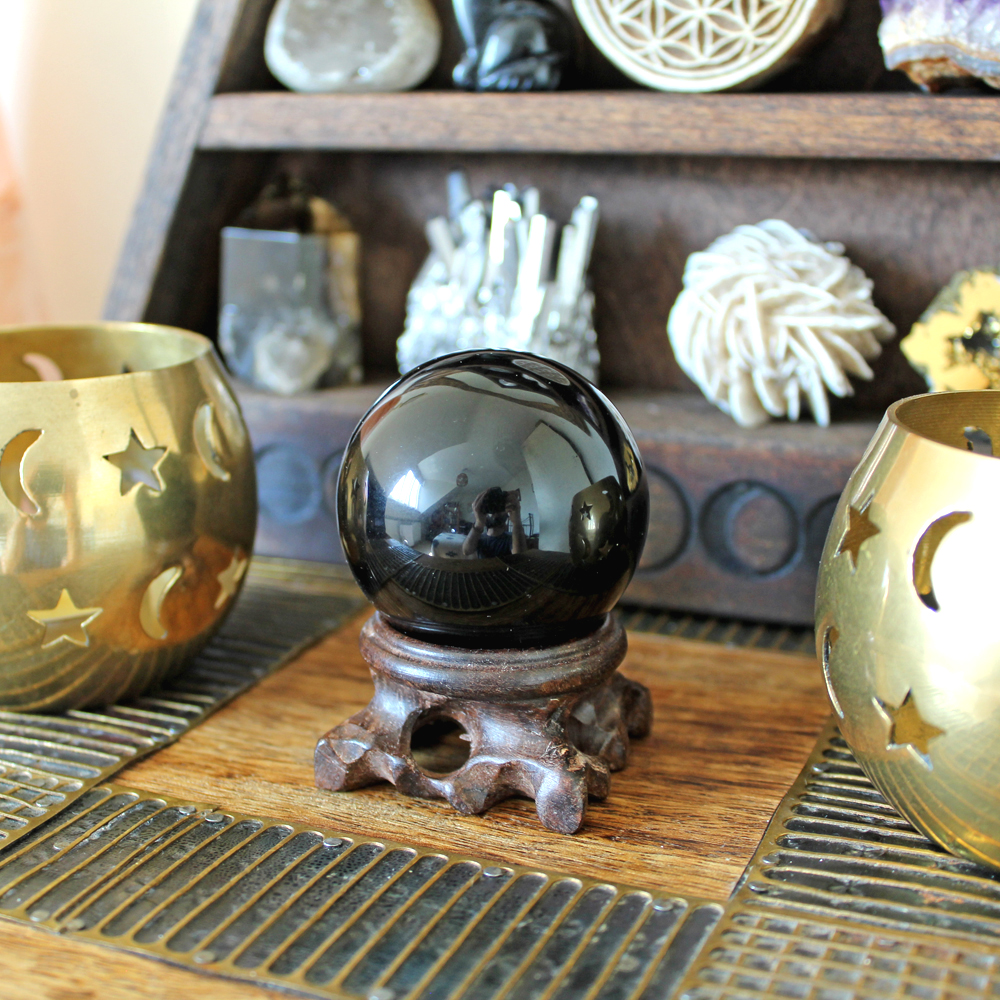 Black Obsidian crystal sphere and candles