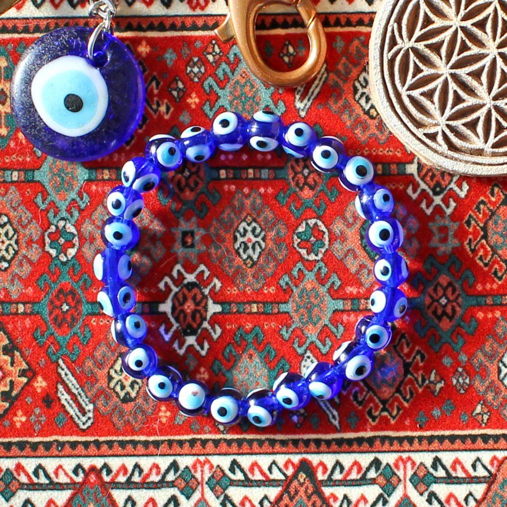Glass evil eye charm and beaded bracelet